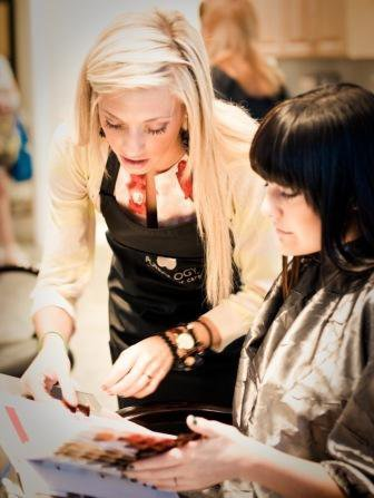 Image of a student enhancing the nails of a model with filing, shaping, cuticle care, a relaxing massage and polish
