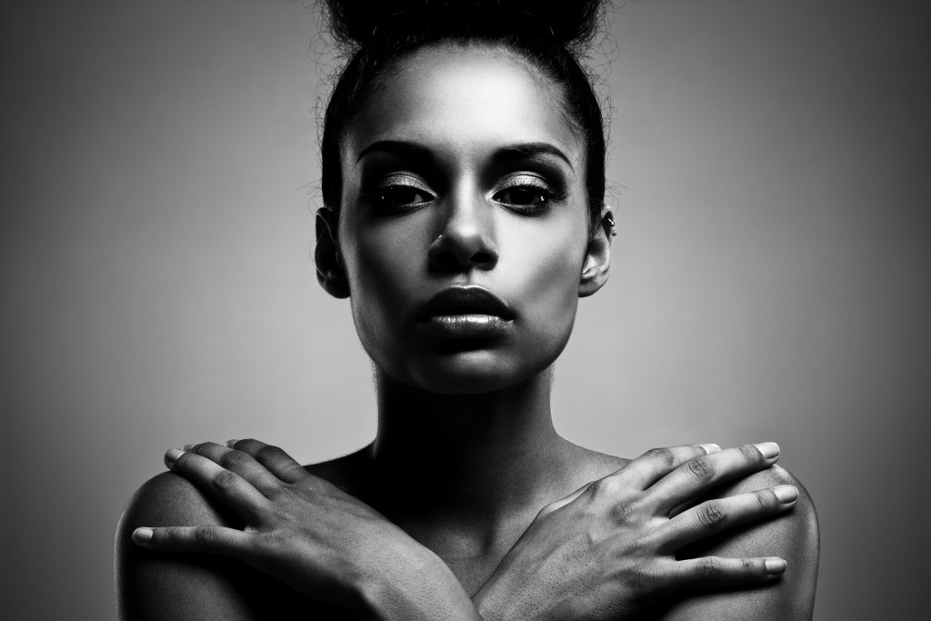 Black and white portrait of a beautiful young African woman.